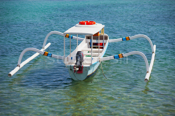 Balinese traditional boat with motor - double outrigger jukung Stock photo © pzaxe