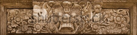 Horrible mythical monster face. Stone relief from Indonesia, Bal Stock photo © pzaxe