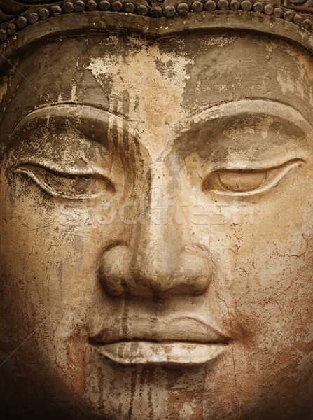 Ancient stone Buddha face close up Stock photo © pzaxe