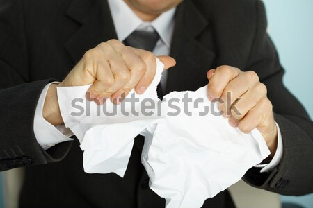 Businessman hands furiously tormenting document Stock photo © pzaxe