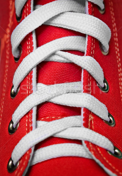 Red old-fashioned gym shoe - lacing Stock photo © pzaxe