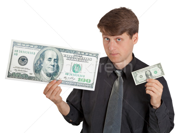 Young man holding large and small money Stock photo © pzaxe