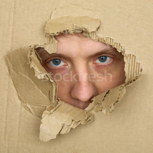 Erkek yüz aramak delik levha Stok fotoğraf © pzaxe