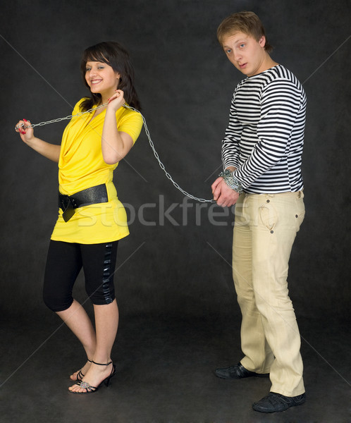 Lady guide shackled young man Stock photo © pzaxe