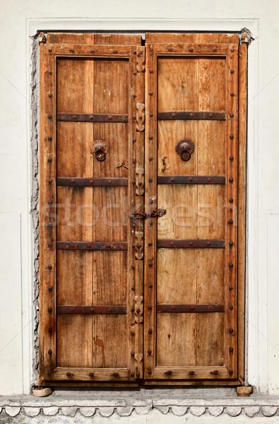 An old dilapidated wooden door Stock photo © pzaxe