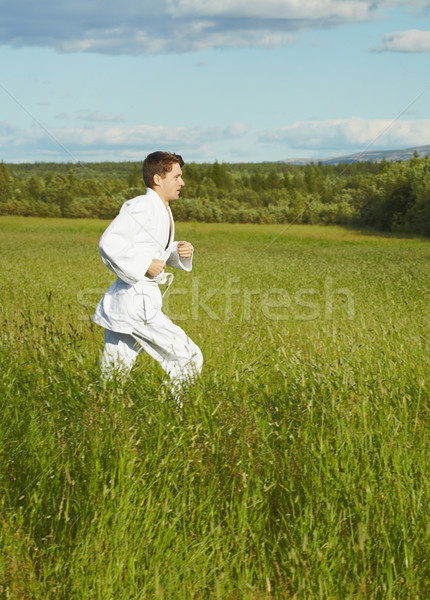 Young man is engaged in run Stock photo © pzaxe