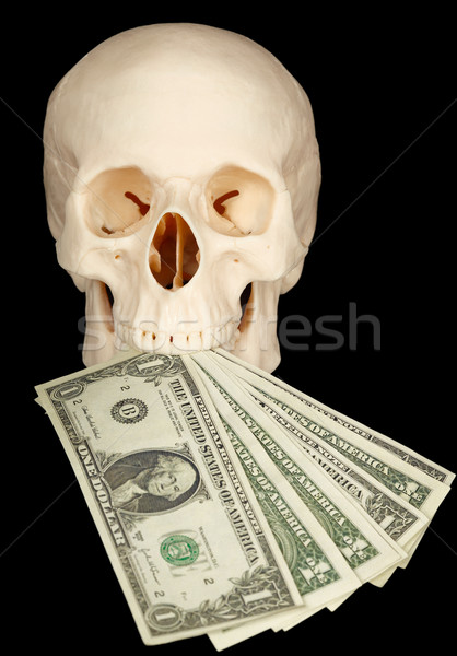 Horrible skull with bundle of money in mouth Stock photo © pzaxe