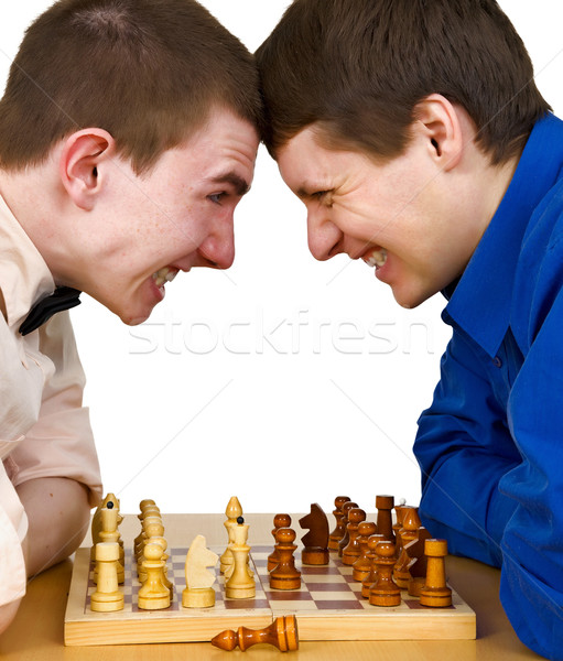Two aggressive chess opponents under chess board Stock photo © pzaxe
