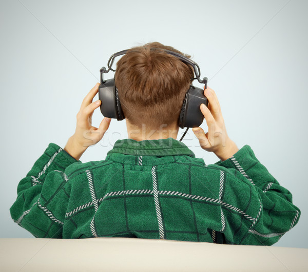 Man listens to symphonic music at home on couch Stock photo © pzaxe