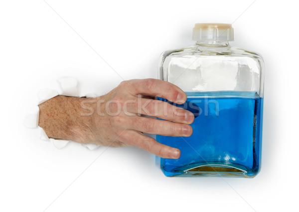 Kéz üveg gyúlékony kék folyadék nagy Stock fotó © pzaxe
