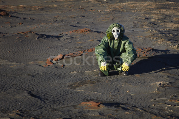 Man in protective clothing sitting in desert Stock photo © pzaxe