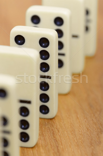 Dominoes on wooden surface abreast Stock photo © pzaxe