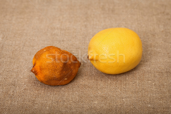 Two fruit against canvas - bad and good lemons Stock photo © pzaxe