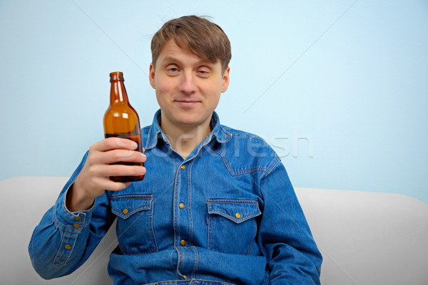 Man relaxing with a bottle of beer Stock photo © pzaxe
