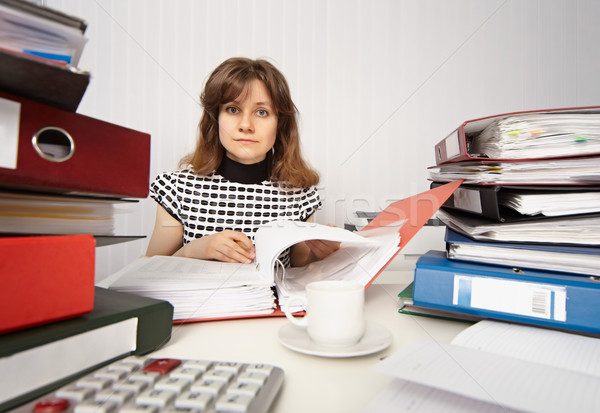 Female accountant very busy in office Stock photo © pzaxe
