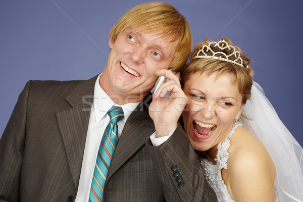 Happy bride and groom is congratulated by phone Stock photo © pzaxe