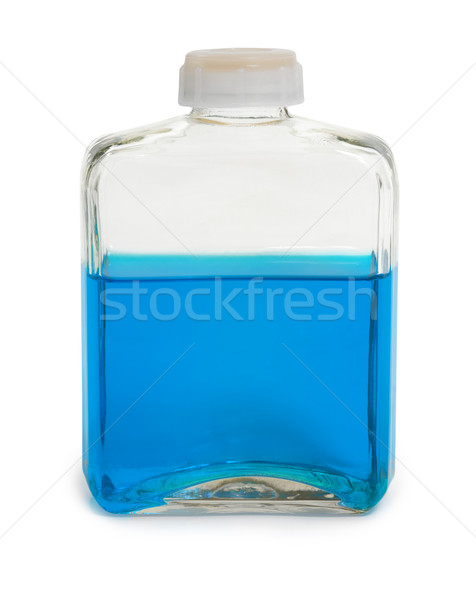 Bottle filled with blue chemical solution Stock photo © pzaxe