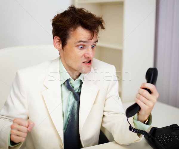 Very angry businessman in office Stock photo © pzaxe