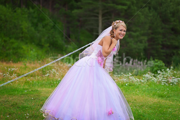 Bride pulls a steel chain Stock photo © pzaxe