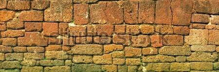 Old stone block wall. Thailand, Ayutthaya. Panoramic photo Stock photo © pzaxe