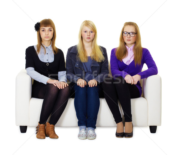 Three girls teen sitting on the couch Stock photo © pzaxe