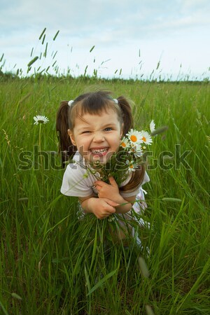 Happy child jumps on green grass in field Stock photo © pzaxe