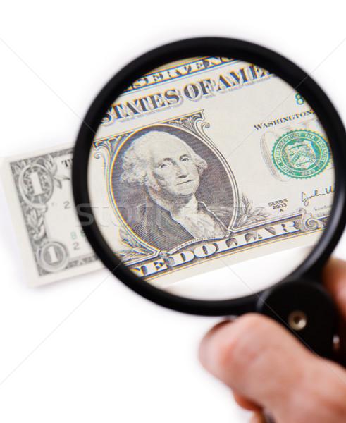 Counterfeit dollar on magnifier Stock photo © pzaxe