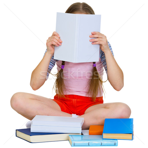 Stock photo: Girl reading the book