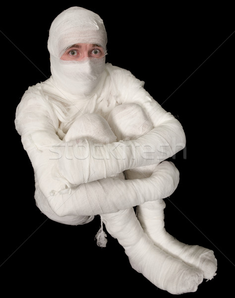 Egyptian mummy emo sitting on a black Stock photo © pzaxe