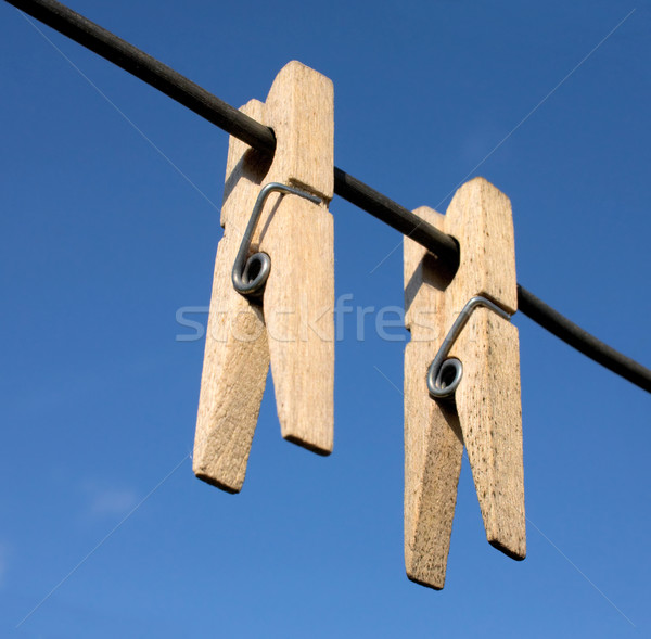 Two wooden clothes-peg Stock photo © pzaxe