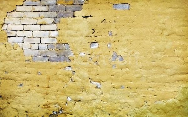 Brick wall with broken plaster Stock photo © pzaxe