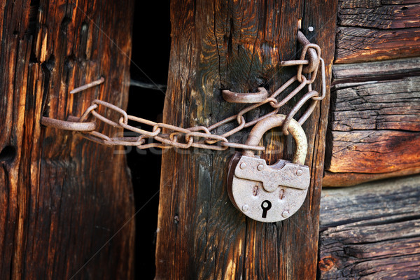 Old rusty padlock on rural wooden gate Stock photo © pzaxe