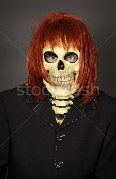 Funny man in mask a skull and wig Stock photo © pzaxe