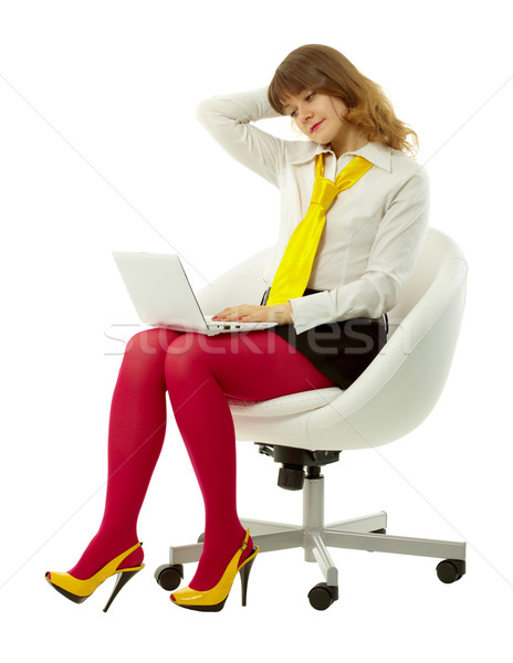 attractive girl in a bright clothing with a laptop Stock photo © pzaxe