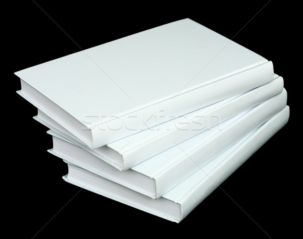 Pile from four book volumes on a black Stock photo © pzaxe