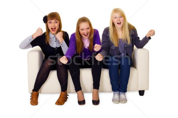 Jubilant young woman on sofa Stock photo © pzaxe