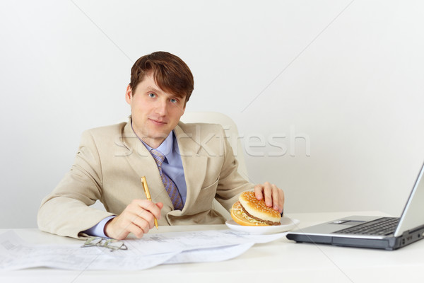 Businessman is going to eat delicious sandwich without interrupt Stock photo © pzaxe