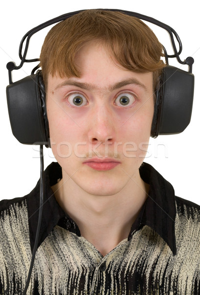Szórakoztató fiatalember fülhallgató szemek arc férfi Stock fotó © pzaxe