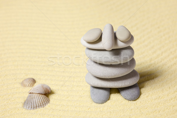 Amusing figure of man from pebble on sand Stock photo © pzaxe