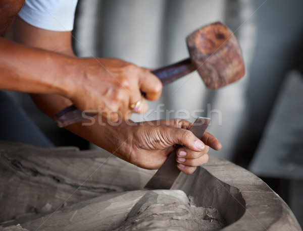 Hands woodcarver with the tools Stock photo © pzaxe