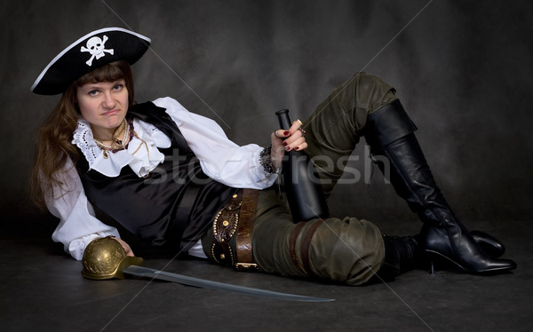 Girl - pirate with rapier and bottle Stock photo © pzaxe