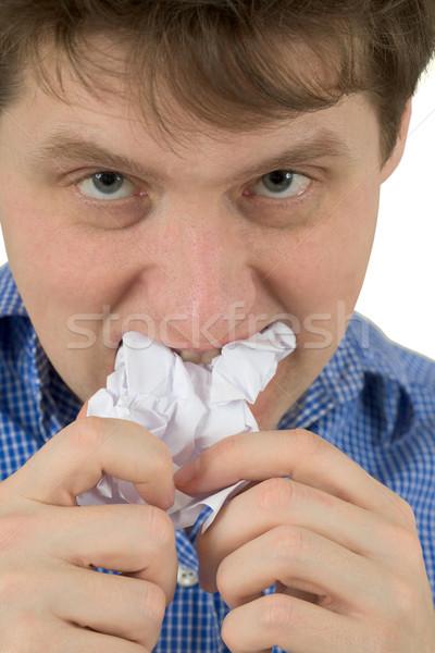 Homem mastigar folha papel branco fundo Foto stock © pzaxe