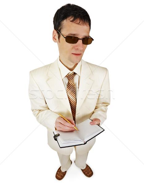Man licht pak notebook witte zakenman Stockfoto © pzaxe