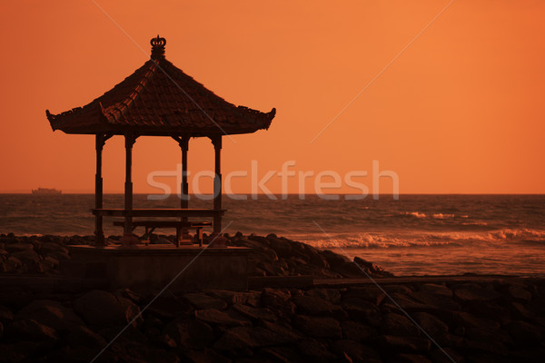 Gazebo on the ocean shore at sunset. Indonesia, Bali Stock photo © pzaxe