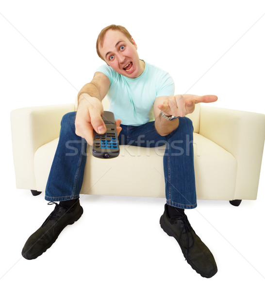 Man with TV remote control Stock photo © pzaxe