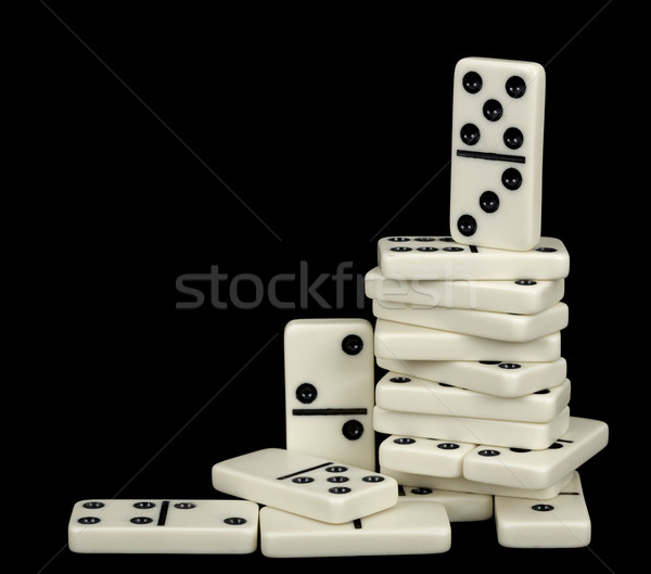 Heap of white dominoes isolated on black Stock photo © pzaxe