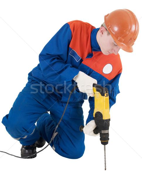Arbeider hand boor helm Geel man Stockfoto © pzaxe
