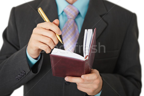 Business people record information in a notebook Stock photo © pzaxe