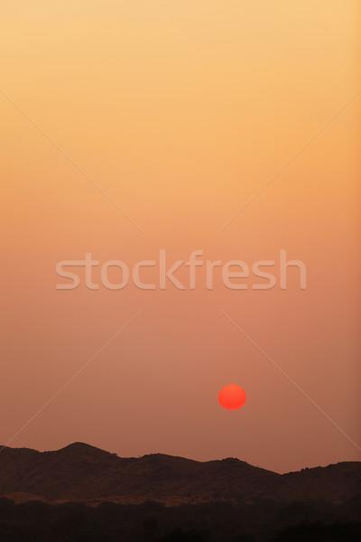 Coucher du soleil collines vertical paysage ciel rose Photo stock © pzaxe
