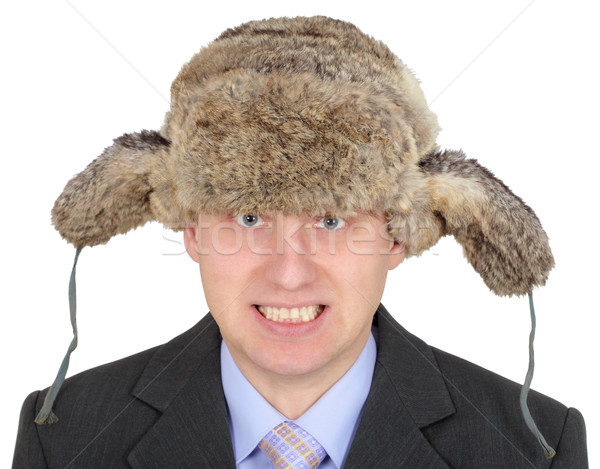 Angry Russian businessman in fur hat on white Stock photo © pzaxe